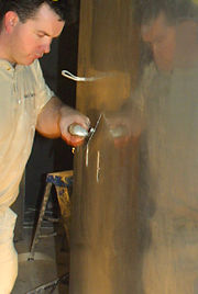 Bart Walsh polishes plaster to a mirror finish